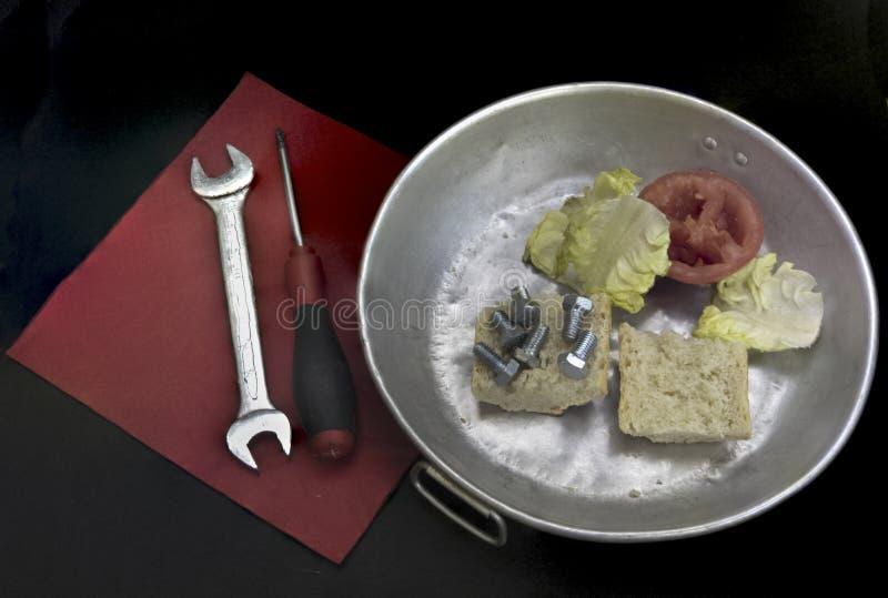 Nourriture avec des outils photo stock