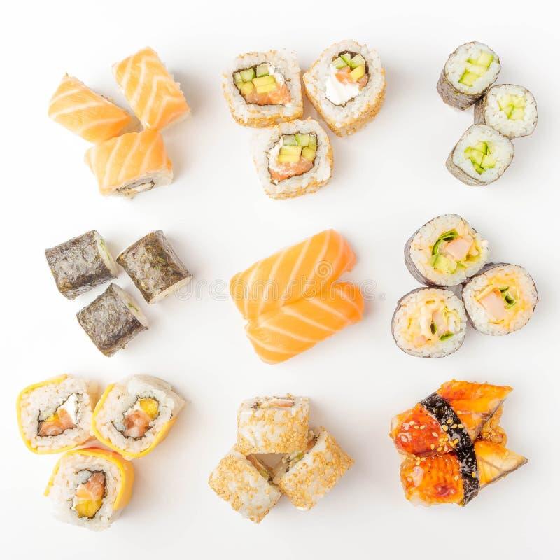 Nourriture japonaise : Ensemble de sushi et de petits pains saumonés avec les saumons et l'anguille, d'isolement photo stock