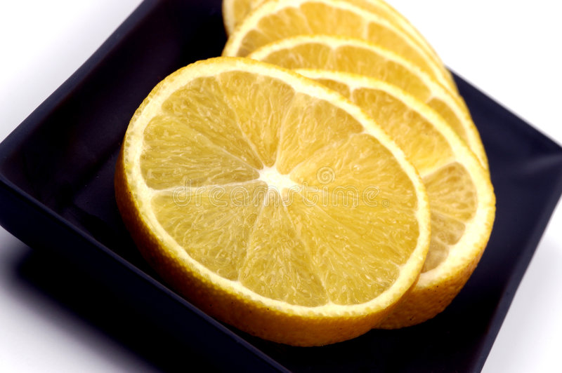 Nourriture - parts oranges photo stock