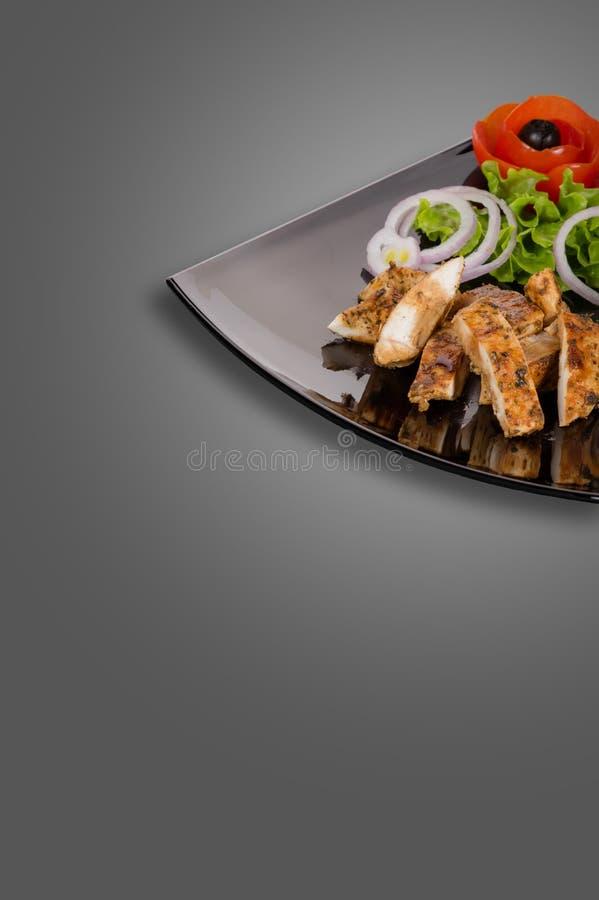 Nourriture saine du plat d'isolement sur le gris image stock