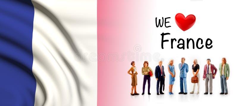 Nous aimons des Frances, groupe de personnes d'A posons à côté du drapeau français illustration libre de droits