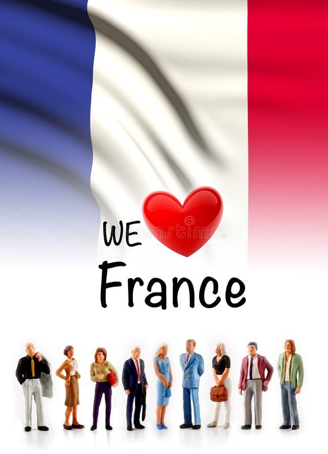 Nous aimons des Frances, groupe de personnes d'A posons à côté du drapeau français photographie stock libre de droits