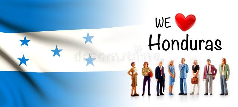Nous aimons le Honduras, groupe de personnes d'A posons à côté du drapeau hondurien illustration libre de droits