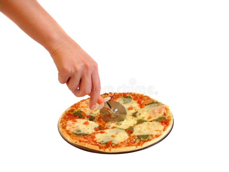 Nous avons coupé une pizza. Isolement image stock