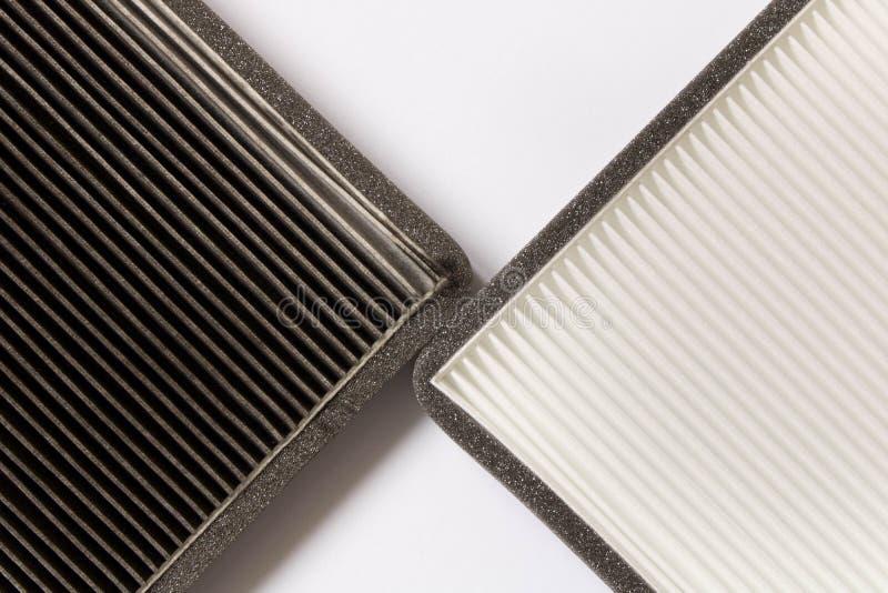 Nouveau et vieux filtre à air de voiture Fin vers le haut image stock
