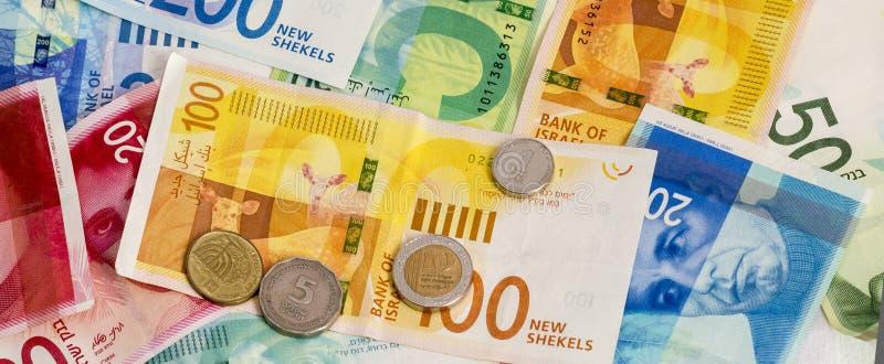 Nouveau fond israélien de billets de banque et de pièces de monnaie de shekel Ima conceptuel images stock