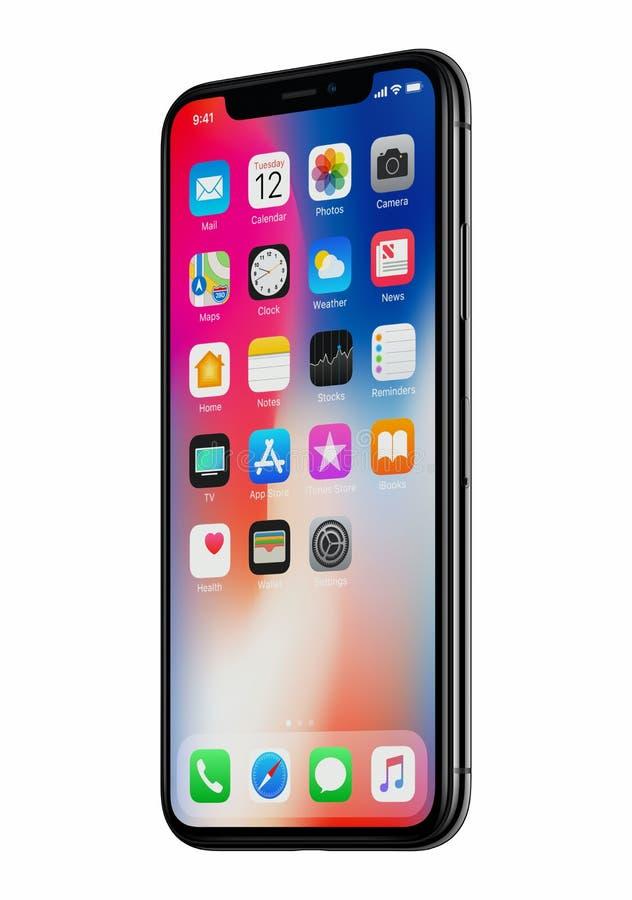 Nouveau la vue de face de l'iPhone X d'Apple a légèrement tourné d'isolement sur le fond blanc photographie stock libre de droits