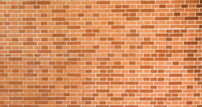 Nouveau mur de briques décoratif rouge-orange et brun reconstitué images stock