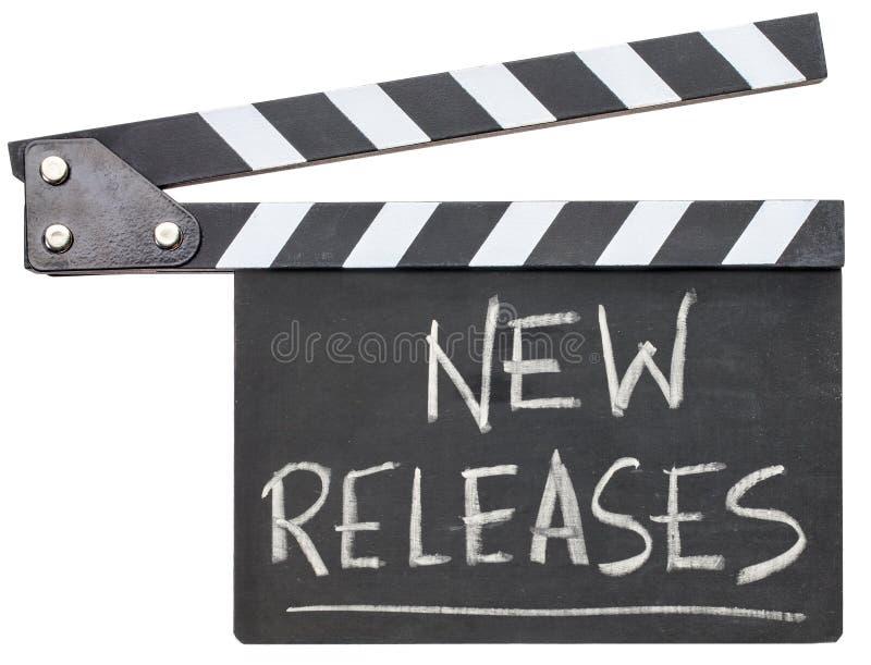 Nouveau texte de libérations sur le bardeau photographie stock libre de droits