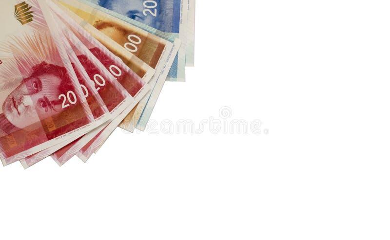 Nouveaux billets de banque israéliens de shekel sur le fond blanc Copiez s images libres de droits