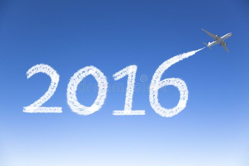 Nouvelle année 2016 dessinant en avion dans le ciel photo libre de droits