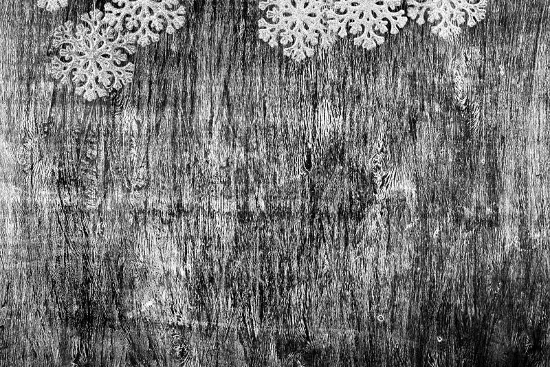 Nouvelle année et fond noir et blanc de Noël d'un bois photographie stock