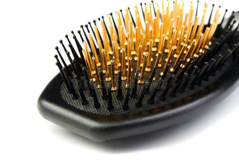 Nouvelle brosse à cheveux moderne d'isolement sur le fond blanc photos stock