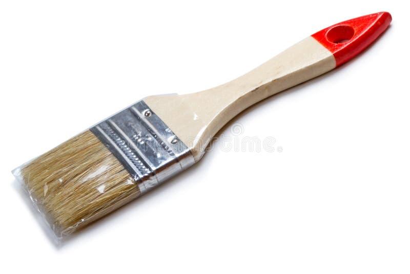 Nouvelle brosse dans la cellophane photos stock