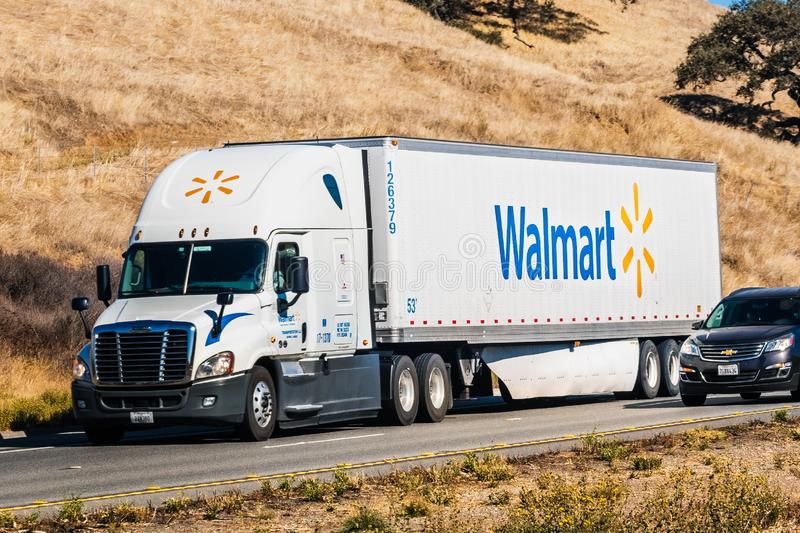 Nov 10, 2019 Hollister / CA / USA - Walmart truck driving on the freeway among hills covered in dry grass royalty free stock photography