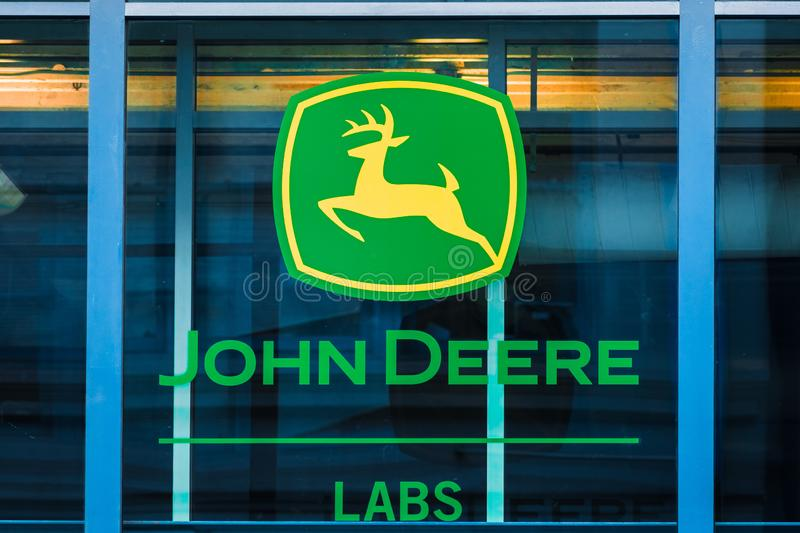 Nov 17, 2019 San Francisco / CA / USA - John Deere sign at their office building; John Deere is the brand name of Deere & Company stock images