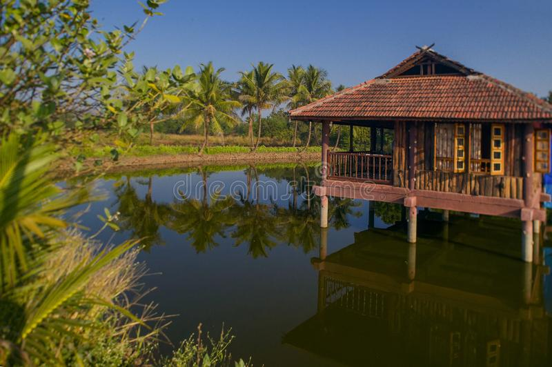 Small artificial lake in the beautiful Resort with wooden House for family activities Neral Maharashtra INDIA. 24 Nov 2005-Small artificial lake in the beautiful royalty free stock photography