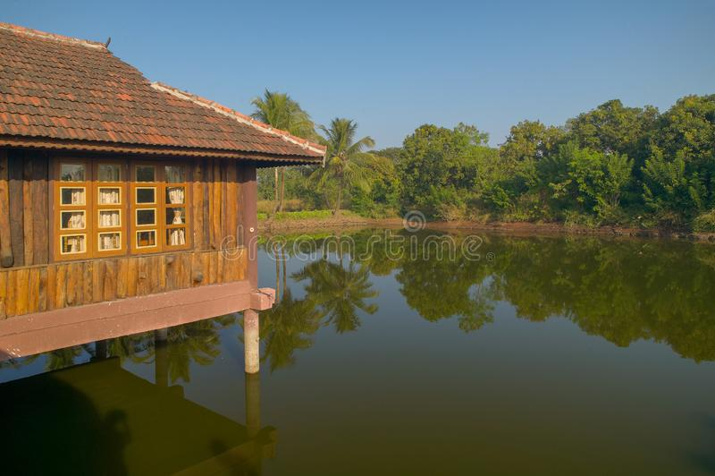 Small artificial lake in the beautiful Resort with wooden House for family activities Neral Maharashtra INDIA. 24 Nov 2005-Small artificial lake in the beautiful royalty free stock photo