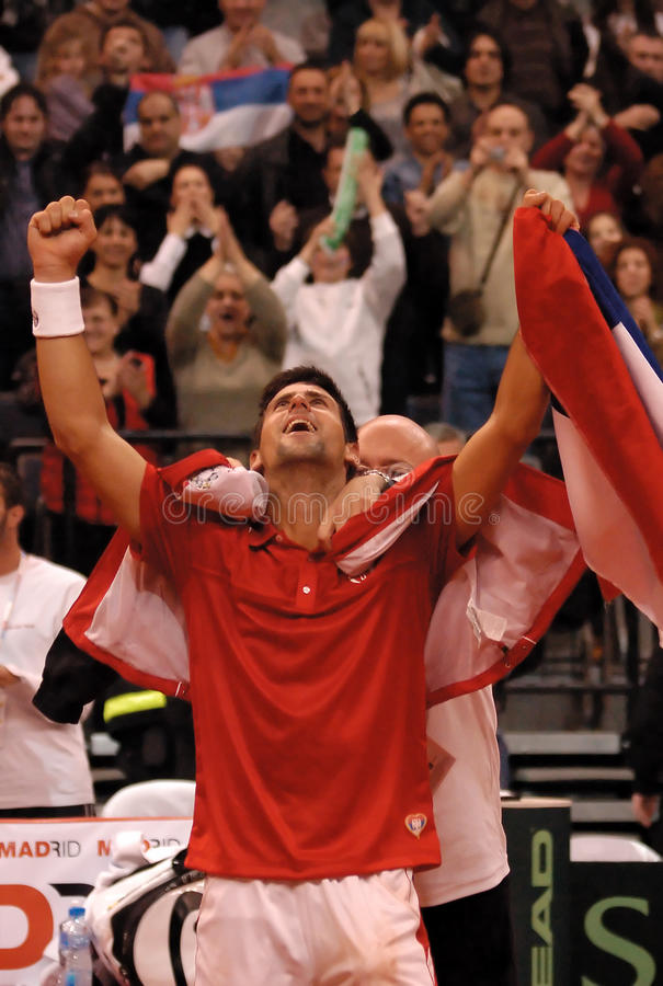 Novak Djokovic-10. BELGRADE - MARCH 7: Serbian Novak Djokovic celebrate a victory against Amerikan John Isner during DAVIS CUP SERBIA - USA, MARCH 7, 2010 in stock photography