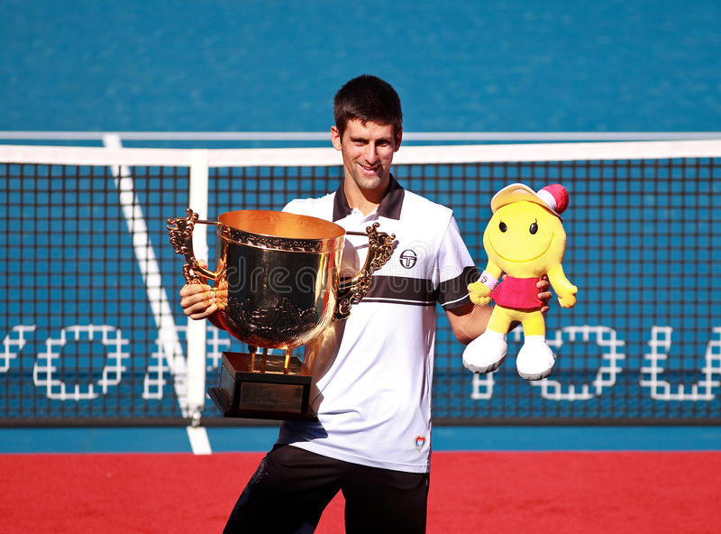 Novak Djokovic at the 2010 China Open. BEIJING-OCT 11: Novak Djokovic of Serbia poses with his trophy after winning in the men's singles final against David stock photo