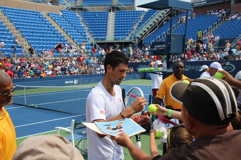 Novak Djokovic. Top tennis player Novak Djokovic signing autographs for fans during the opening of the US Open, New York Image taken 8/24/2012 royalty free stock photo