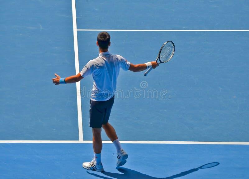 Novak Djokovic bawić się w australianie open zdjęcie stock
