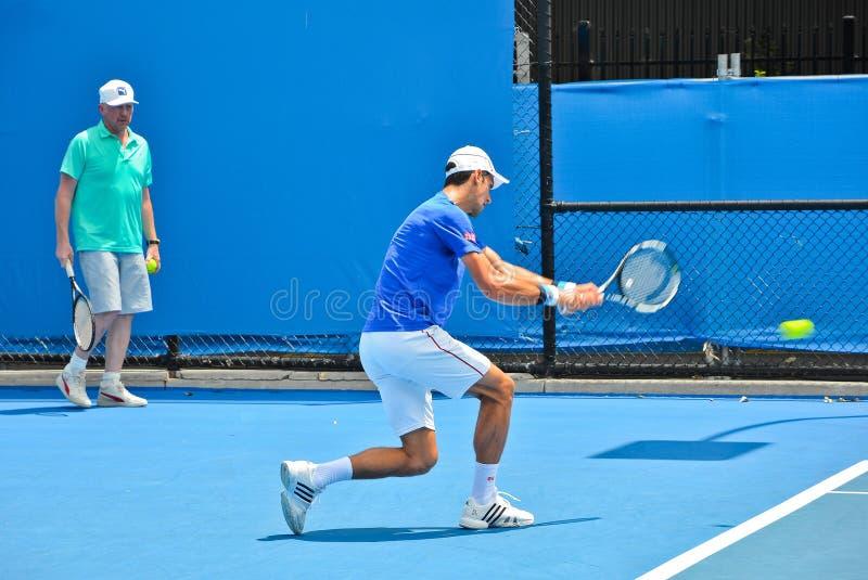 Novak Djokovic-het praktizeren met Boris Becker royalty-vrije stock foto's