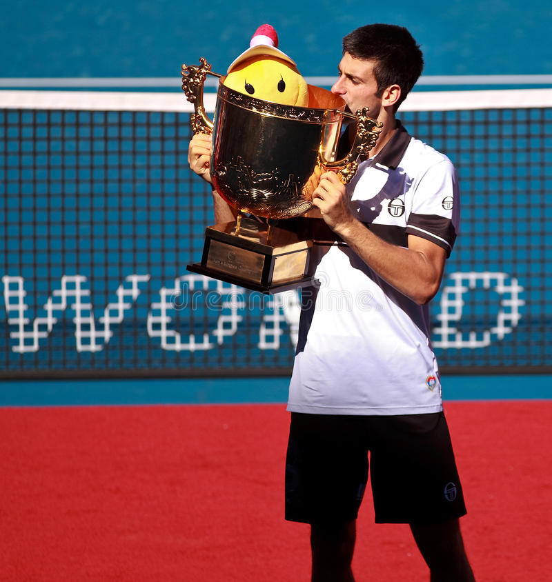 Novak Djokovic of Serbia. BEIJING-OCT 11: Novak Djokovic of Serbia poses with his trophy after winning in the men's singles final against David Ferrer of Spain stock photography