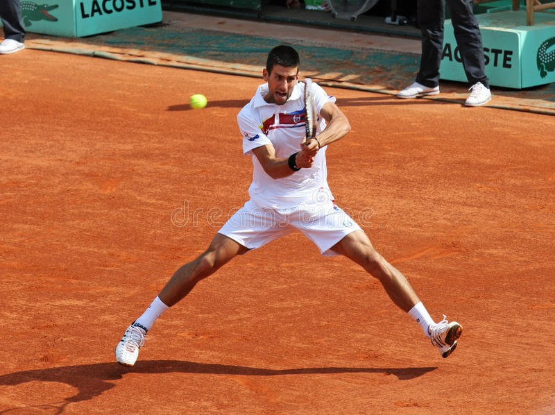 Novak Djokovic (SRB) at Roland Garros 2011. PARIS - MAY 21: Novak Djokovic of Serbia plays the exhibition match at French Open, Roland Garros on May 21, 2011 in royalty free stock photography