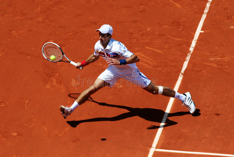 Novak Djokovic (SRB) at Roland Garros 2011. PARIS - MAY 23: Novak Djokovic of Serbia plays the 1st round match at French Open, Roland Garros on May 23, 2011 in stock photos