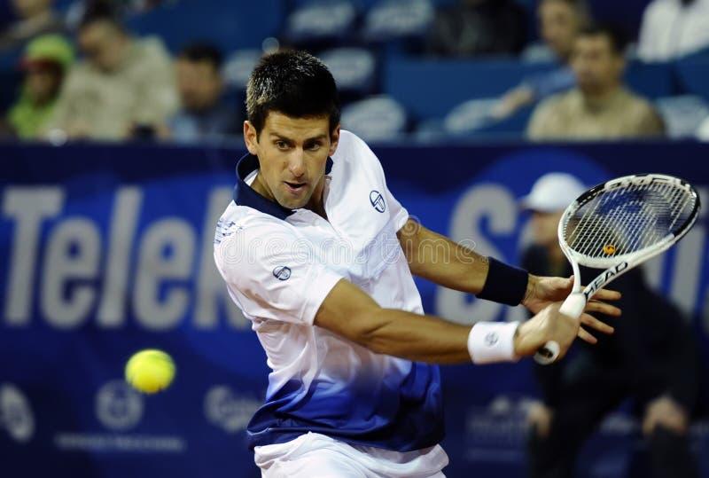 Novak Djokovic wraca piłkę podczas Serbia Otwartego dopasowania przeciw Fabio Fognini obrazy royalty free