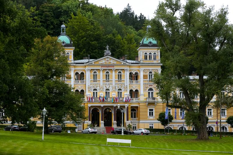 The Nove Lazne Hotel is surrounded by trees royalty free stock photography