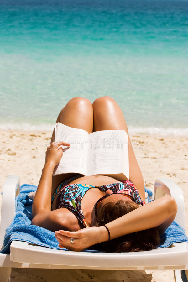 Download Novel at beach stock photo. Image of relaxation, leisure - 6075918
