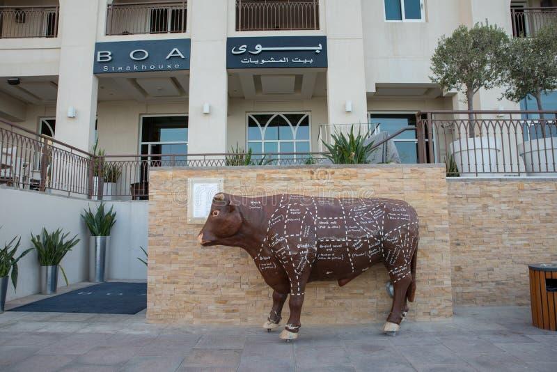 Beef types and names marked on Sculpted bull at BOA Steakhouse Abu Dhabi. November 10, 2018 _ Abu Dhabi, UAE: Beef types and names marked on Sculpted bull at BOA stock image
