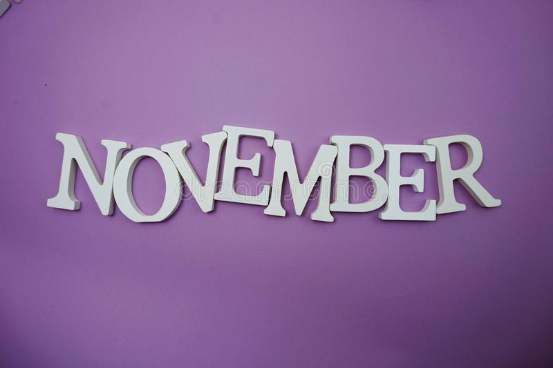 November alphabet letter with space copy on Purple background. Top view of November alphabet letter with space copy on Purple background stock images