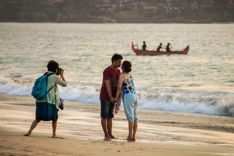 13 November 2012. Bali Kuta Beach. Photographer taking pictures stock images