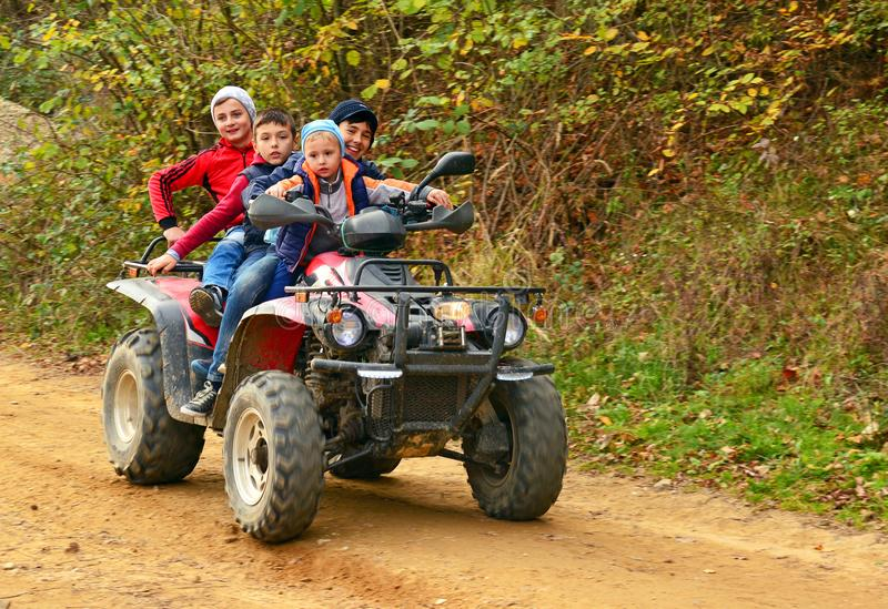 Kids on quad bike royalty free stock photography
