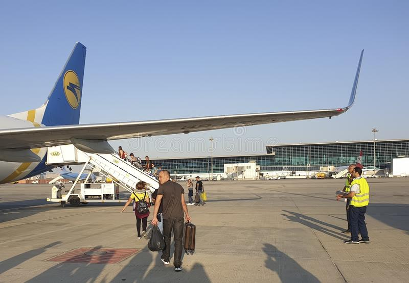 November 7, Egypt Hurghada boarding plane airline Ukraine International Airlines. November 7 Egypt Hurghada plane airline Ukraine International Airlines boarding royalty free stock photography