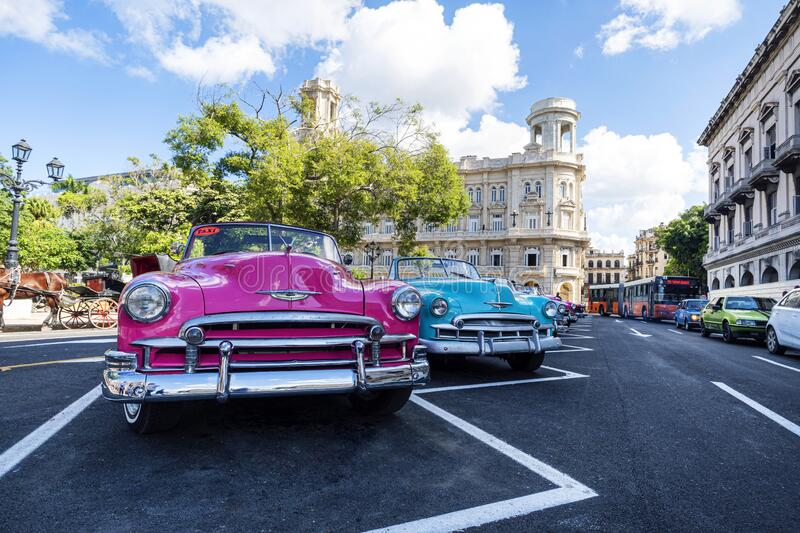 Classic retro cars Chevrolet in different bright colors are parked in front of the national Museum of fine arts on the square, royalty free stock image