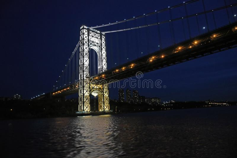 November 11, 2007, The Hudson River, Near Inwood Park, New York City. The Brightly Lit East Tower of The George Washington Bridge. The brightly lit East Tower of stock images