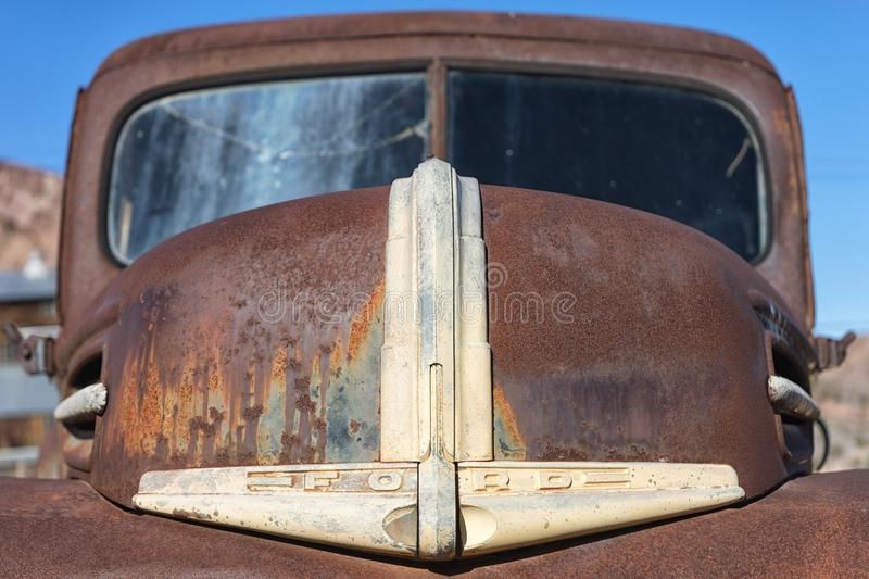 Front end closeup of a vintage rusty vehicle. November 9, 2015 Nelson, Nevada, USA: front end closeup of a vintage abandoned classic car in the desert stock photography