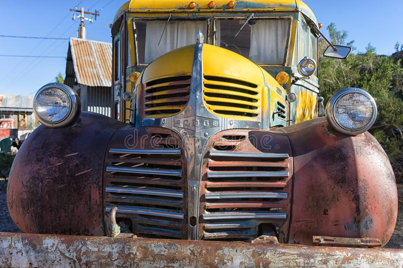 Front end closeup of a vintage bus. November 9, 2015 Nelson, Nevada, USA: front end closeup of a vintage abandoned classic truck in the desert stock image