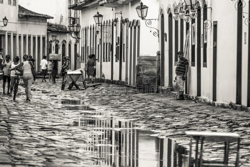 The historical colonial city of Paraty reflected on the water puddles after the rain royalty free stock image