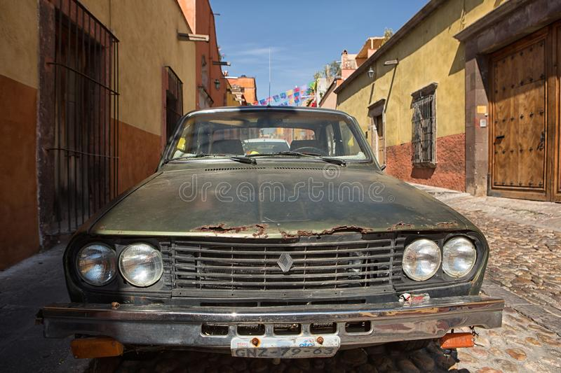 Old rusty car in Mexico. November 19, 2014 San Miguel de Allende, Mexico: the high number of old vehicles are creating a raised level of emission in Latin royalty free stock photos