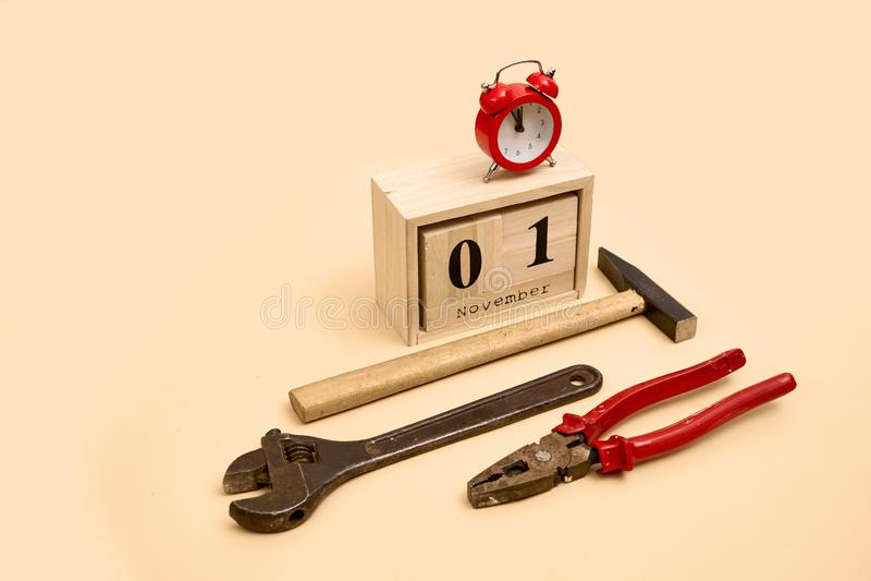 November 1st. Day 1 of November set on wooden calendar on on beige background royalty free stock photography
