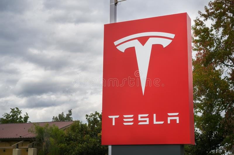 November 2, 2017 Sunnyvale/CA/USA - Tesla logo in front of a showroom located in San Francisco bay area; cloudy sky in the. Background royalty free stock image