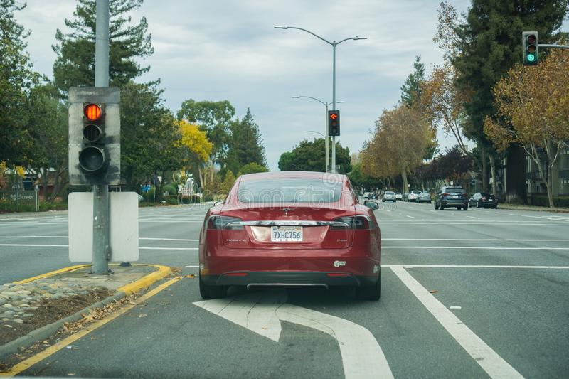 November 23, 2017 Sunnyvale/CA/USA - Tesla Model S P85D stopped at a traffic light on a cloudy day royalty free stock photos