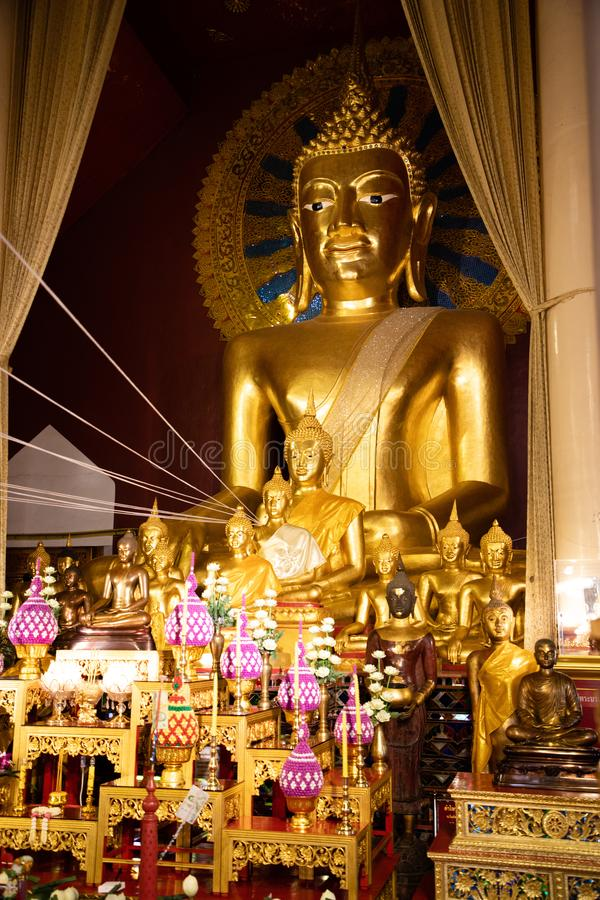 November 21th, 2018 - Ayutthaya & x28;THAILAND& x29; - Giant golden Buddha surrounded by smaller golden Buddhas in thai temple stock images