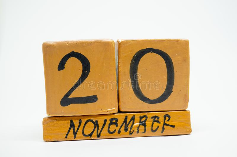 november 20th. Day 20 of month, handmade wood calendar isolated on white background. autumn month, day of the year concept royalty free stock photo
