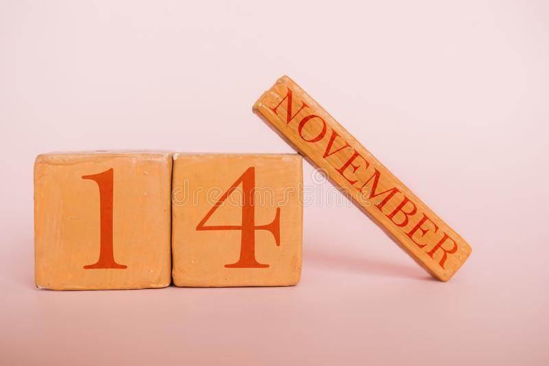 November 14th. Day 14 of month, handmade wood calendar  on modern color background. autumn month, day of the year concept. November 14th. Day 14 of month royalty free stock photos